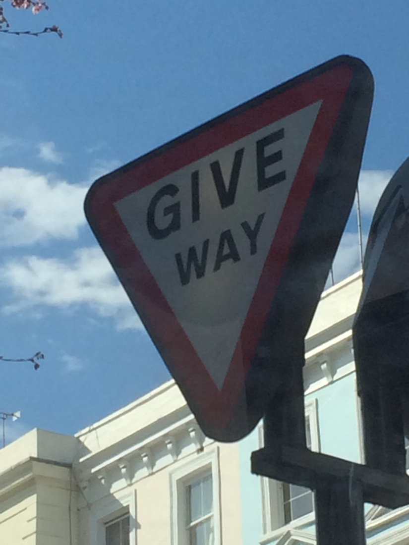 "They use the softer touch of ""Give Way"" instead of the US's stern, forceful ""Yield."""