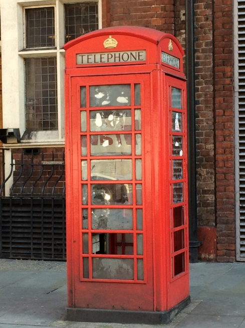 I had to take a picture of a telephone booth.  They're so rare now!