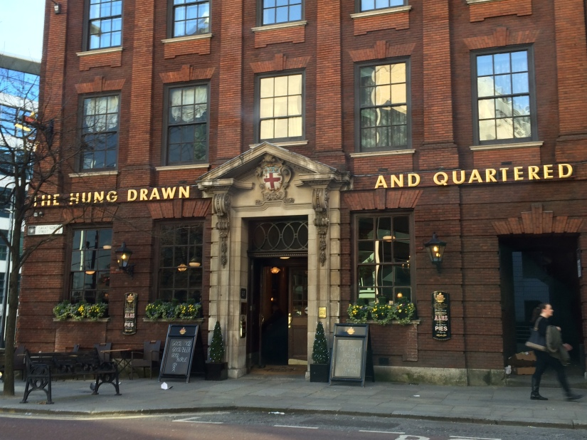 "Here's a pub that needed the help of a comma.  Otherwise, I'm not sure what a ""hung drawn"" is."