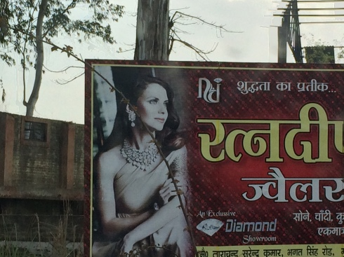 Most women in India never showed their shoulders.  But I guess it was okay for advertising?