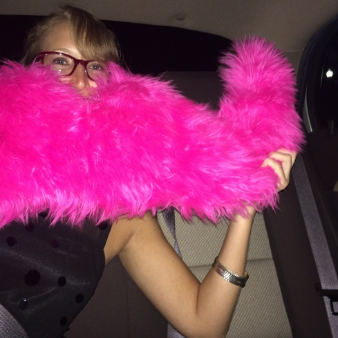 Me playing in the back seat of the Lyft car with the iconic Lyft mustache.